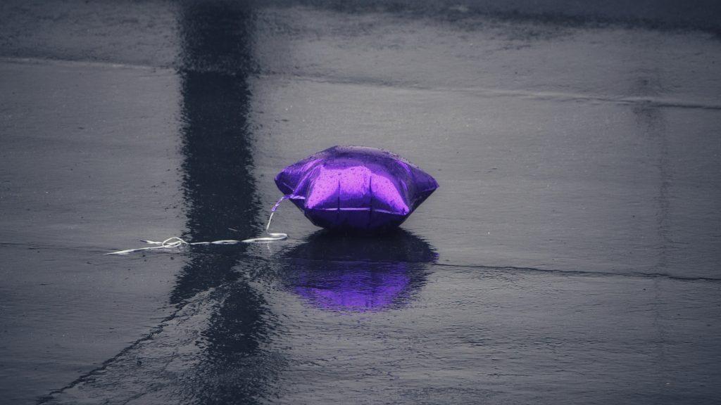 purple balloon on black floor